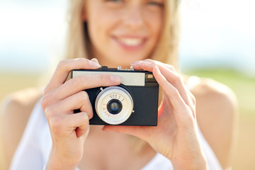 close up of woman photographing with film camera
