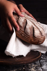 woman hands take fresh bread