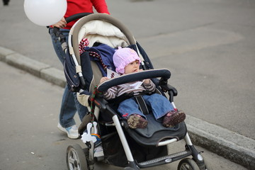 Mother walking with baby in carriage