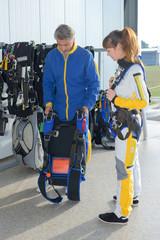 Parachutist holding harness