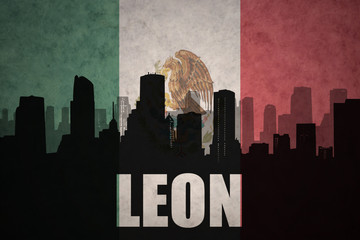 abstract silhouette of the city with text Leon at the vintage mexican flag