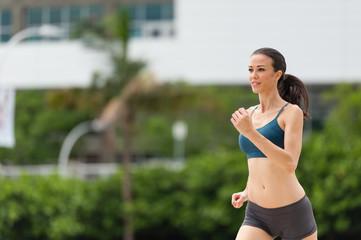 Young Woman Running Jogging