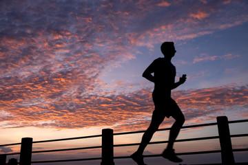 Runner at sunrise along East Bay Street, Charleston, SC