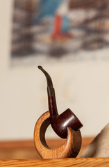 tobacco pipe on a stand on the mantelpiece