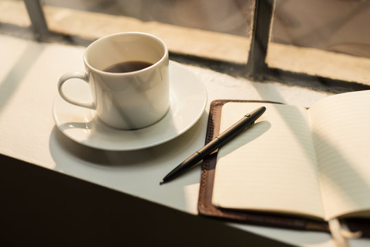 Blank leather journal and coffee