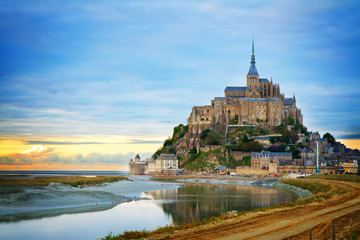Mont St Michel city at sunset, Brittany France, toned Fototapete
