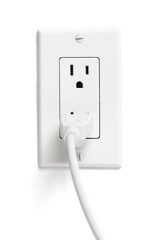 Electrical cord plugged into outlet on white