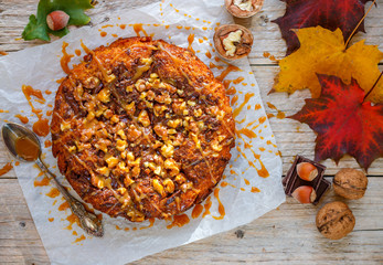 Homemade pumpkin pie with chocolate, nuts and caramel