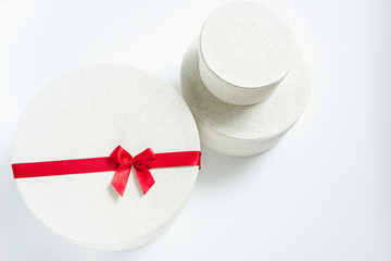Round White Gift Boxes With Red Ribbon
