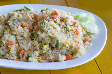 Fried rice with crab on white dish.