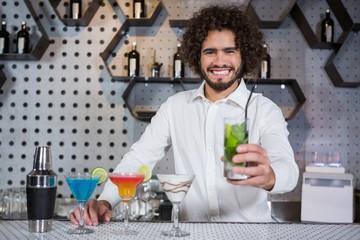 Bartender serving glass of gin