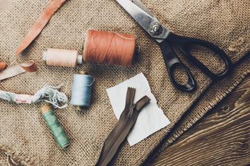 Scissors, bobbins with thread and needles