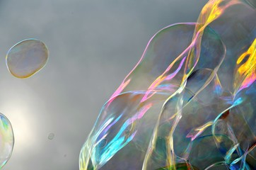 Colorful Bubbles Blowing Against Cloudy Sky