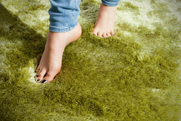 Woman leg on a carpet