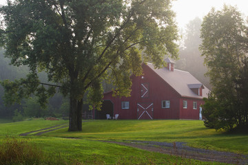 Red barn in early morning fog, Iron Hill, Quebec, Canada