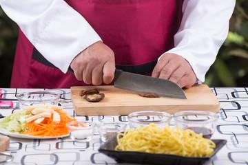 Chef cutting mushroom