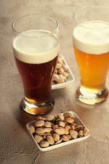 Glasses of beer and pistachio nuts