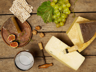 Cheese and wine on wooden table