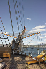 View of a bowsprit of a large wooden sailboat