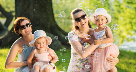 Cheerful women with their cute children