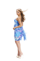 Young beautiful happy blonde woman in blue dress