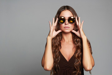 beautiful young woman in sunglasses.fashion beauty stylish girl with healthy long hair