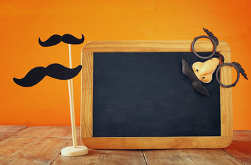 Halloween concept. Blank blackboard with funny mask