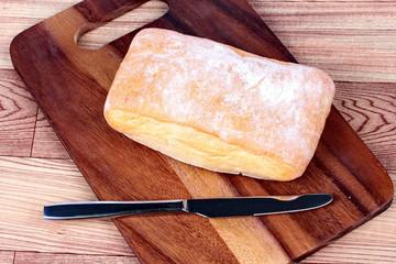 Authentic ciabatta bread on butcher served..