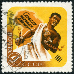 USSR - 1961: shows African Breaking Chains and Map