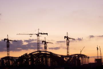 Crane on a construction site at sunrise