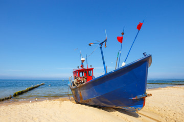 Fishing boat on the beach at summer time