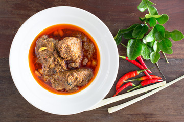 Beef massaman curry on wood background.