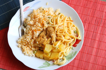 Bowl of Chicken with Rice, Potatoes and Noodles
