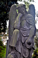 Statue of a contemplative angel