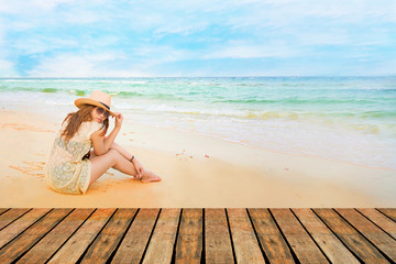 Fashion  of asian beautiful girl  with hippie outfit and hat outdoors at sunset on the sea. Soft warm color tone. Boho lifestyle. Bohemian Style.