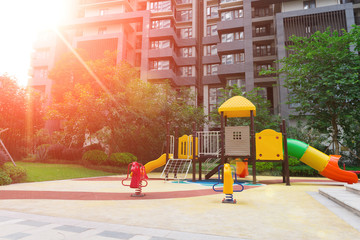 playground for children in residential buildings ina sunny morni
