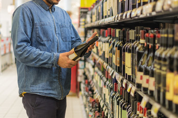 Buying wine at the supermarket.