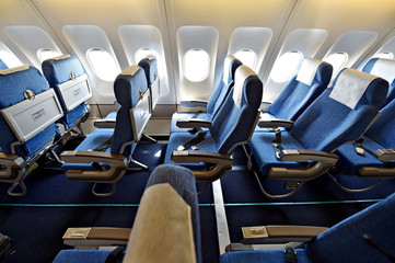 Blue airplane empty seats