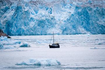 Small boat by Glacier