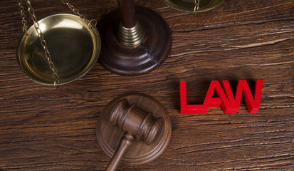 Law theme, mallet of the judge, wooden desk background