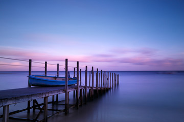 Boat and Pier in Twilight
