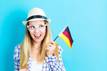 Young traveling woman holding German flag