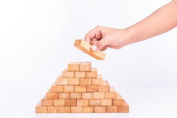 Hand holding blocks wood game (jenga) isolated on white backgrou