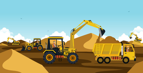 Excavator working at a mound of earth and sand.