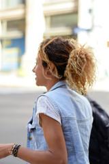 Smiling Brazilian woman walking down