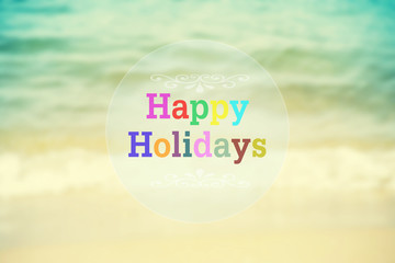 Happy Halidays word on blurred vintage beach abstract background