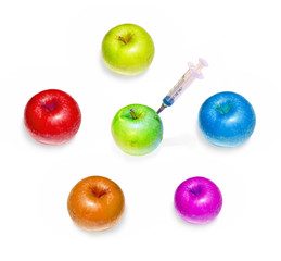 Abstract representation of danger food: Genetically modified apples injected with syringe with soft shadow on white background