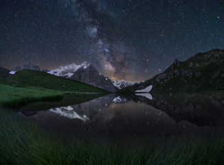 clear milky way and lake reflection in the swiss alps mountains