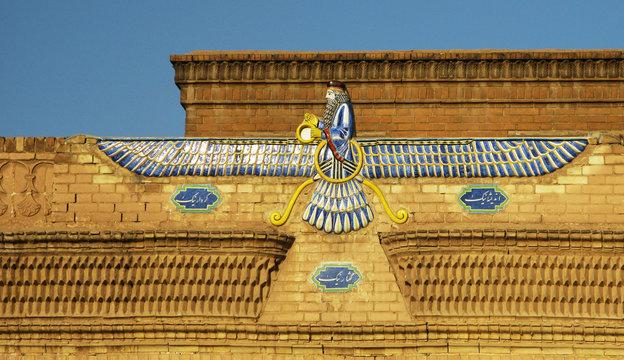 Faravahar, zoroastrian symbol on the temple wall, Yazd, Iran