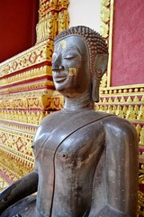 Seated Buddha Image at the veranda's Haw Phra Kaew temple.Vientiane.Laos